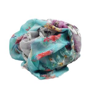 Fular en tonos esmeralda, grises, lilas con estampado de flores. 90% modal y 10% poliester.