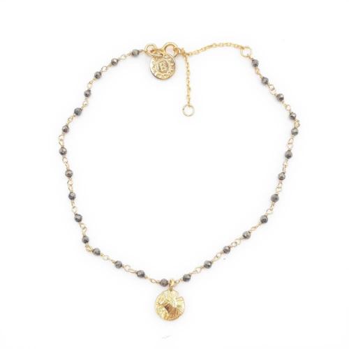 Tobillera rosario con piedras grises y mini circulo dorado. Plata 925 bañado en oro 18k.
