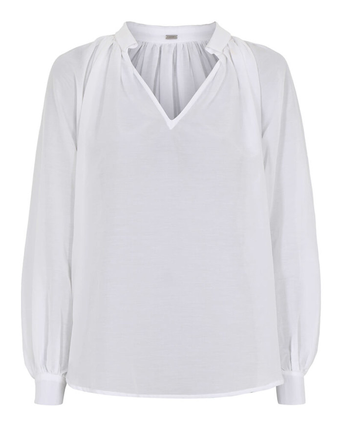 Camisa blanca de algodón , con manga abullonada.